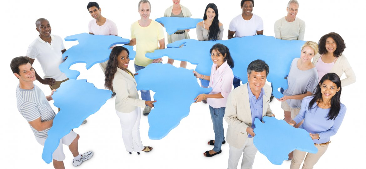 Multiethnic-group-of-casual-people-holding-abstract-world-map-000021292734_Large-1