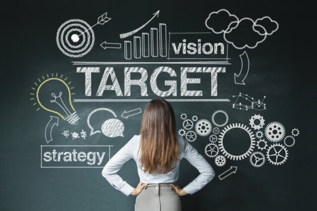 Businesswoman looking at strategy sketch